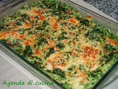 Spinaci al forno con pomodori e acciughe