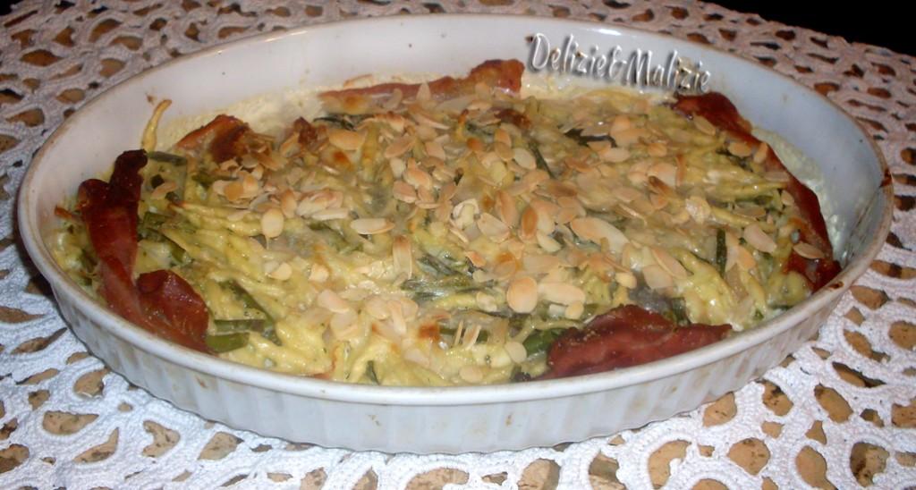 Trofie gratinate con asparagi mandorle e speck