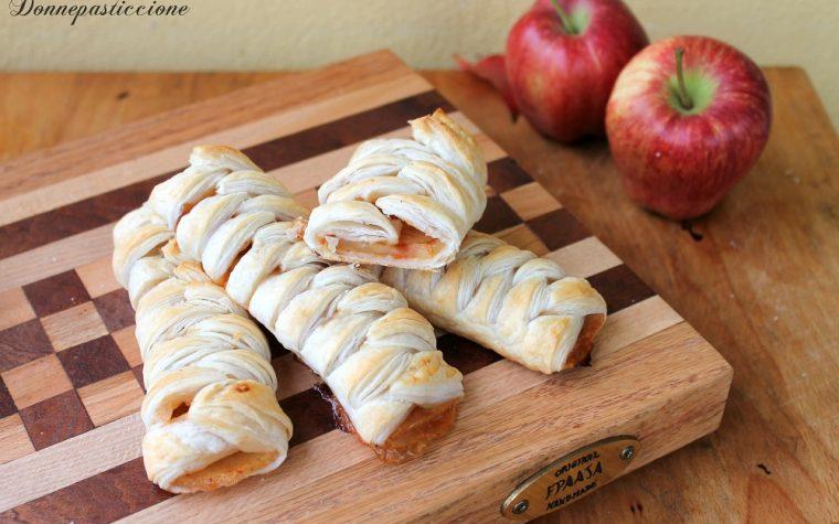 Trecce di pasta sfoglia ripiene di mele e cannella
