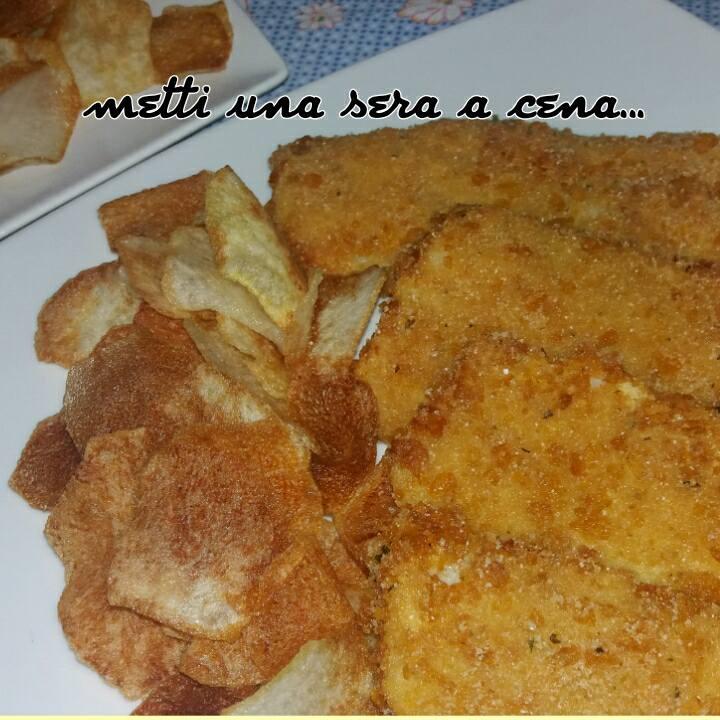 fish and chips ( pesce fritto croccante con patatine )