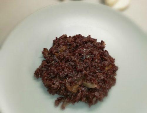 Riso rosso con porcini e finferli