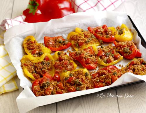 Peperoni gratinati al forno, con pomodorini