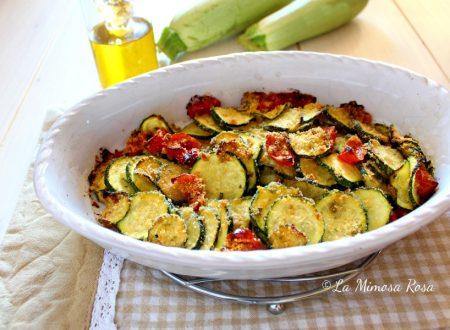 Zucchine gratinate con origano, pomodorini e pangrattato