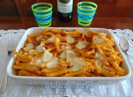 Pasta con pomodorini al forno con piselli