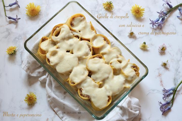Girelle di crespelle con salsiccia e crema di parmigiano