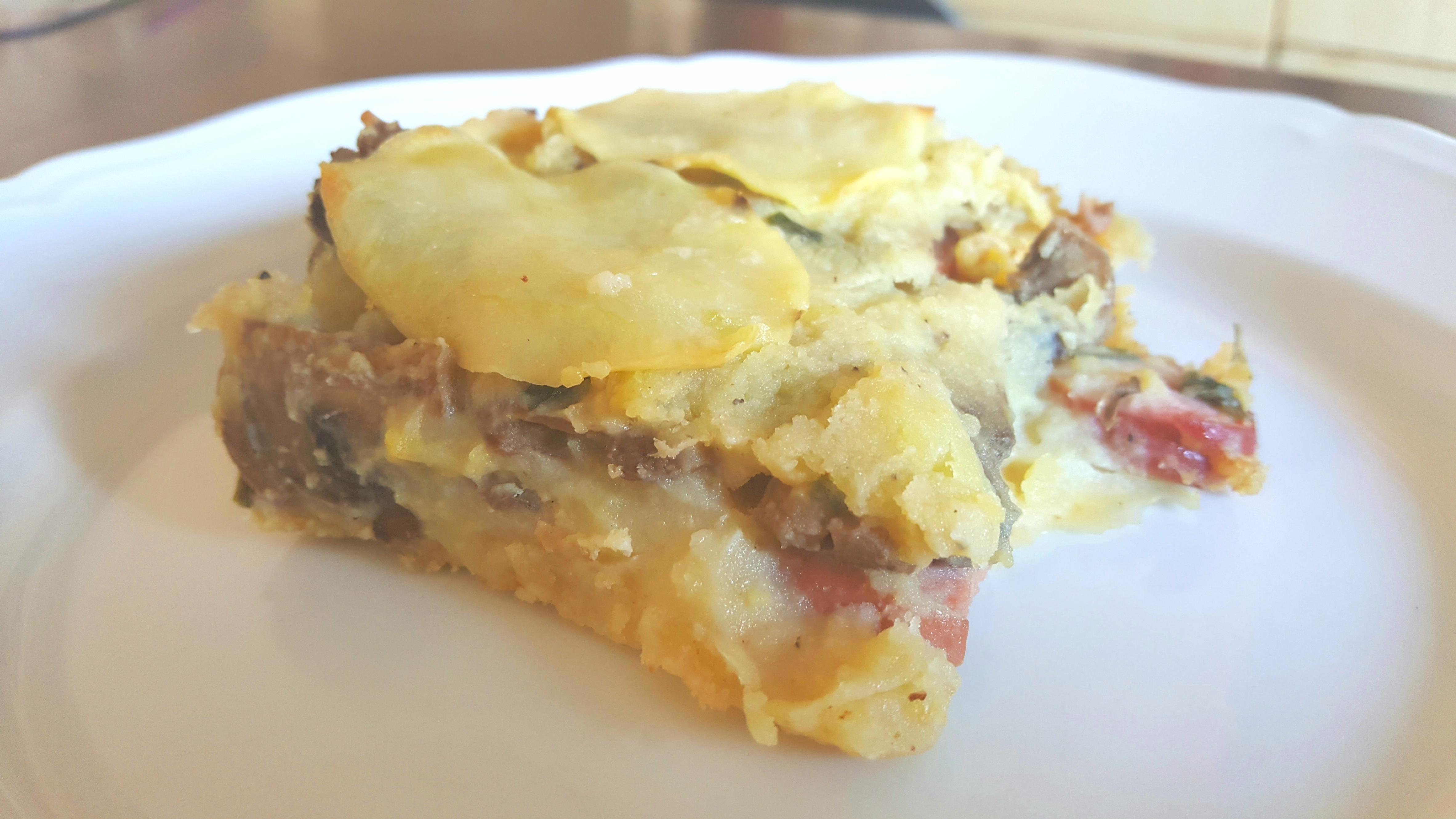 Gatêau di patate, würstel e funghi