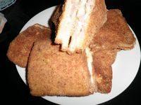 Sandwich con prosciutto e formaggio in carrozza