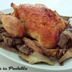 Galletto aromatizzato al forno con carciofi trifolati
