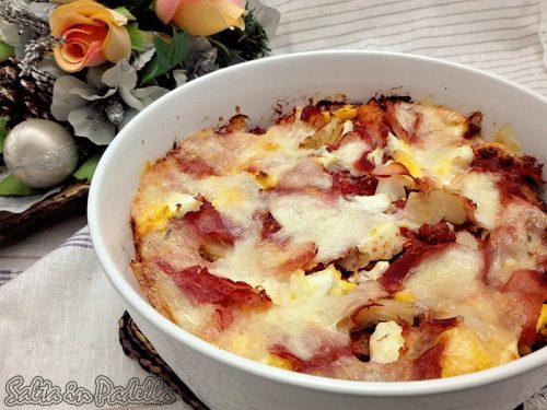 Parmigiana di pane con ragù prosciutto cotto e Auricchietto