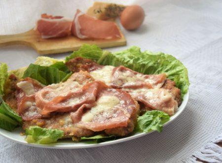 Cotoletta alla bolognese con prosciutto crudo e parmigiano