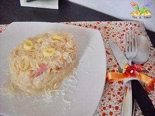 risotto cremoso con speck e porri