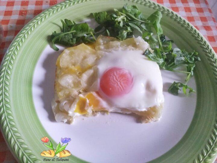 pasticcio di uova con patate e cipolle